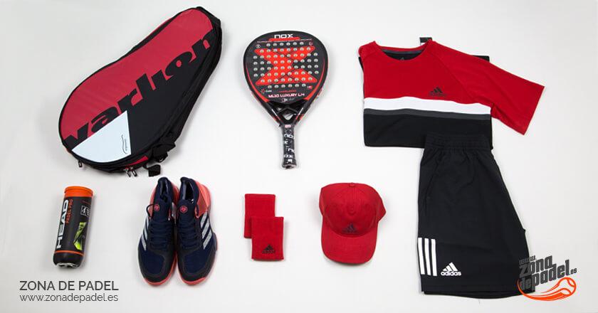 Look de Adidas para pádel donde predomina el rojo y el negro